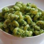 close up of a bowl of broccoli spinach pesto pasta