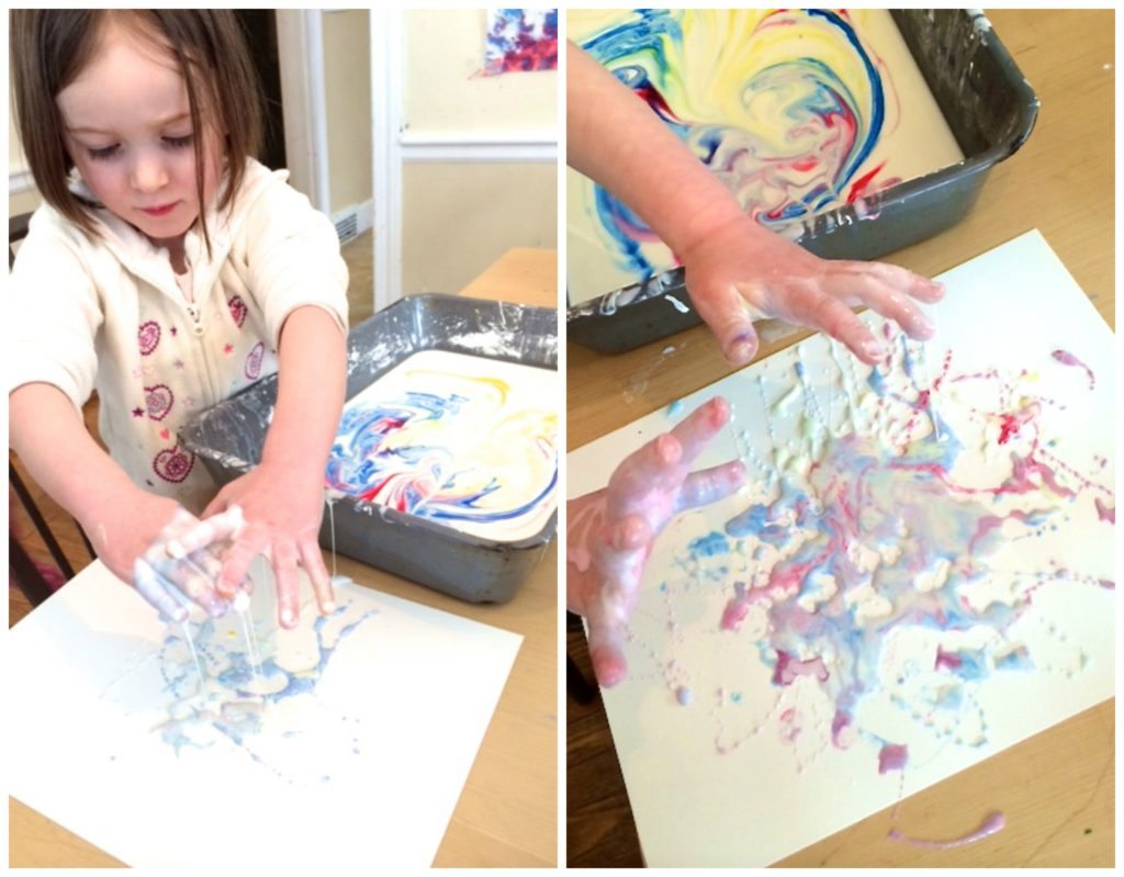 dripping goop on paper to make goop drip sensory painting