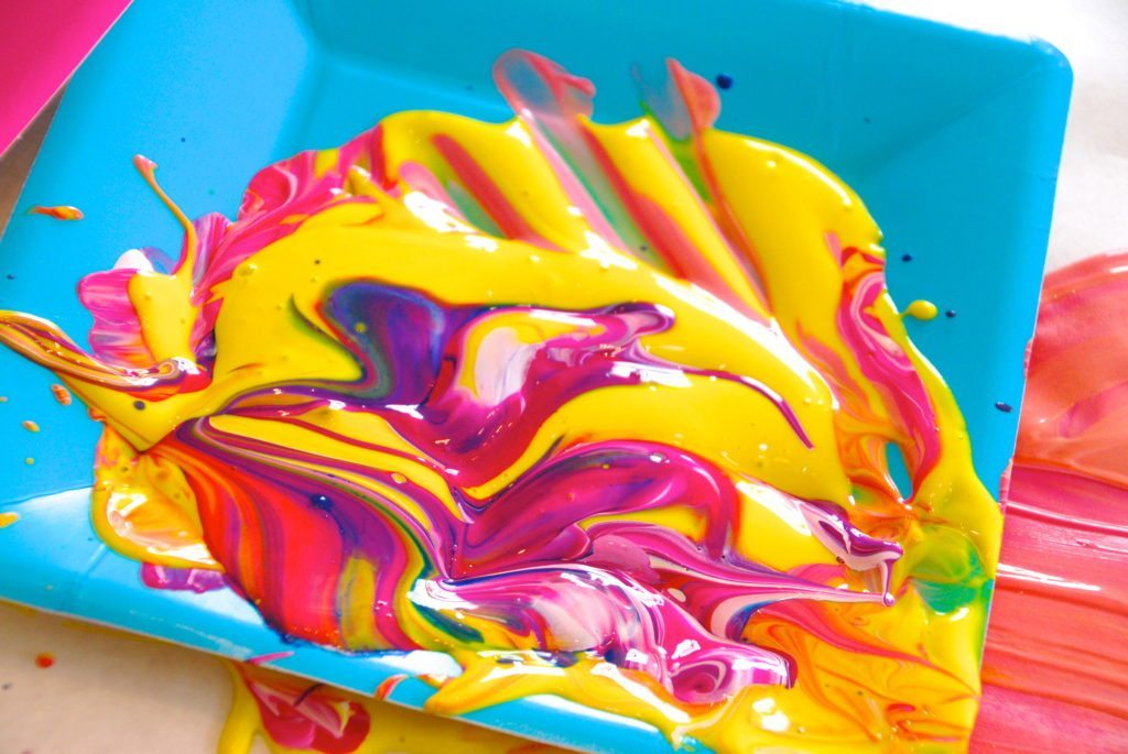 exploring colors is one of the reasons to finger paint with older children