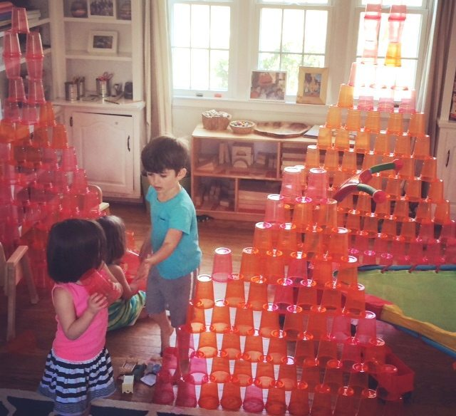 creating cup towers is one of the 5 ways to play with plastic cups