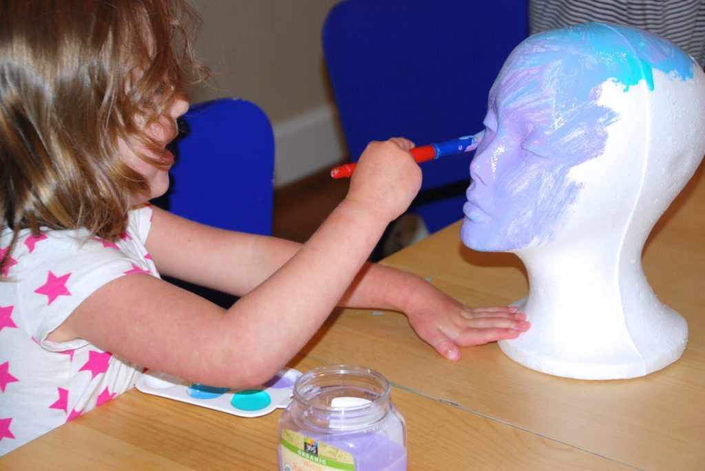 Painting the styrofoam head sculptures for kids