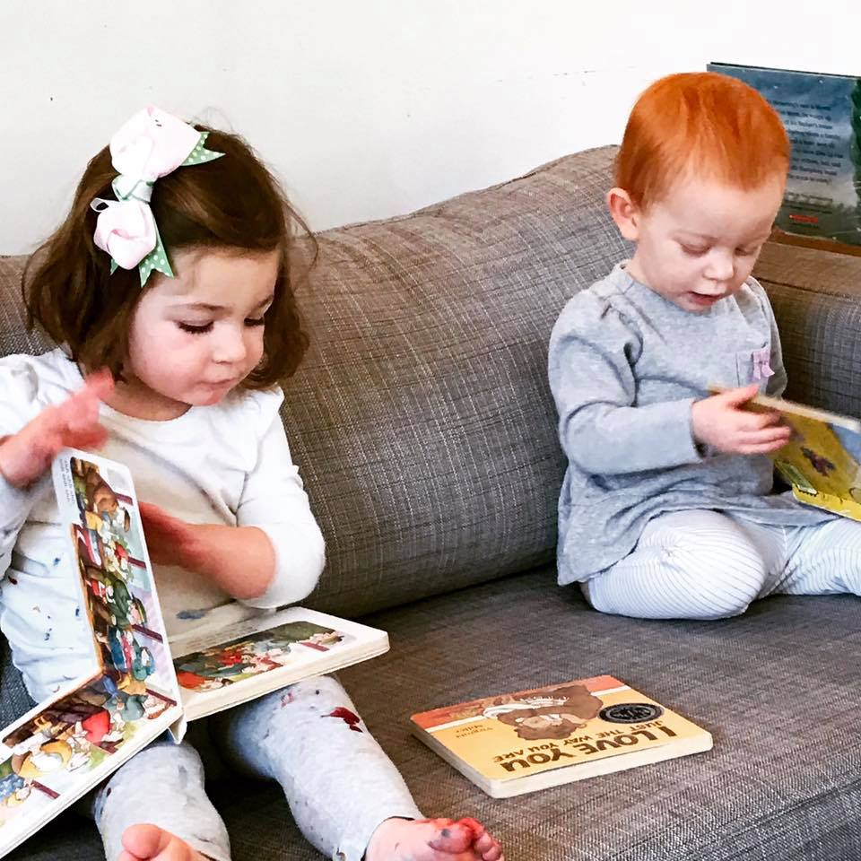 taking a break to read is one of the fun easy toddler playgroup ideas