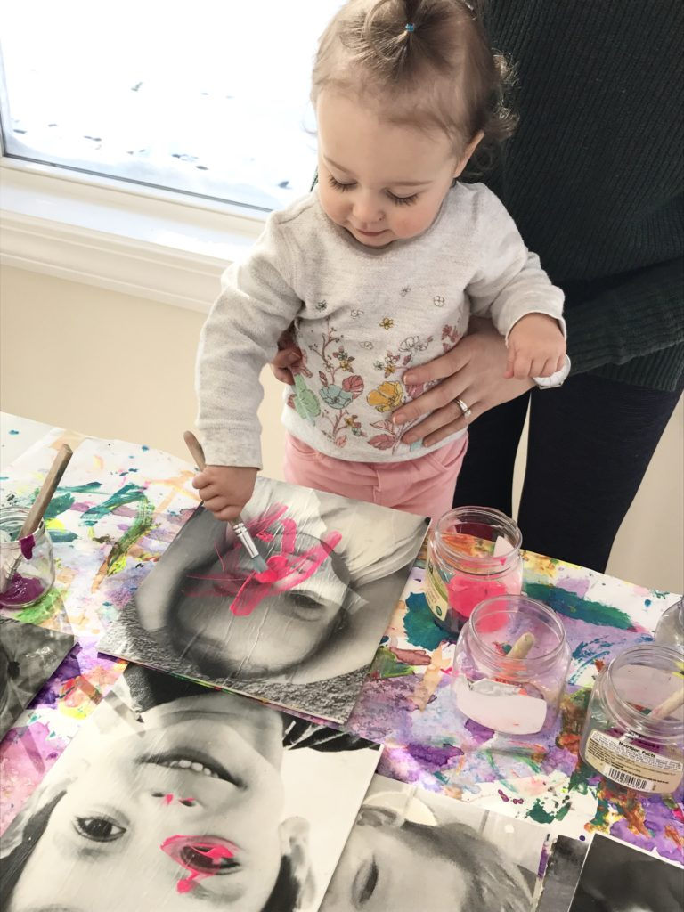 toddler creating one of the Painted Black and White Photograph Portrait Canvases
