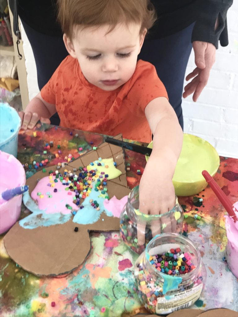 adding sprinkles to the puffy paint ice cream cone craft