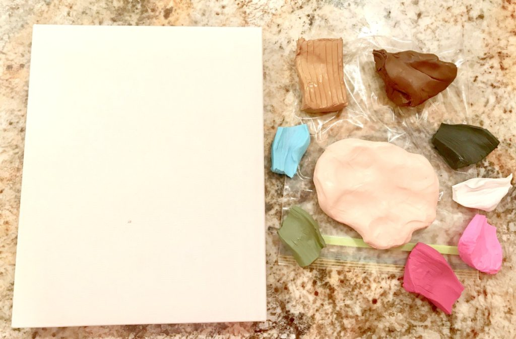 set up Kid Made Clay Self Portrait Canvases