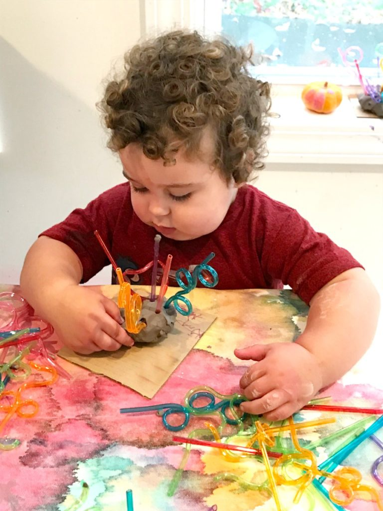 toddler making a Chihuly Inspired Process Art Sculptures